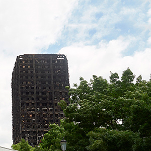"The charred remains of clading are pictured on the outer walls of the burnt out shell of the Grenfell Tower block in north Kensington, west London on June 22, 2017. Combustible cladding has been found in ""a number"" of publicly-owned tower blocks in Britain following emergency checks ordered after the June 14 devastating fire at Grenfell Tower, British Prime Minister Theresa May said Thursday. ""A number of these tests have come back as combustible,"" May said in a statement to parliament after ordering checks on all similar blocks.   (NIKLAS HALLE'N/AFP/Getty Images)"