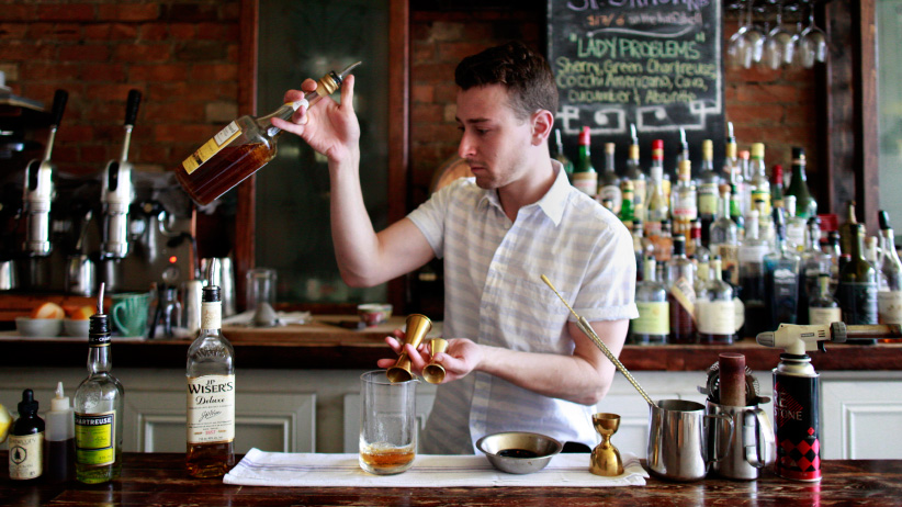 Jacob Wharton-Shukster makes a smoked whisky at Chantecler in Toronto. (Marta Iwanek/Toronto Star/Getty Images)