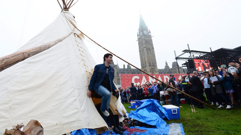Prime Minister Justin Trudeau leaves a teepee on Parliament Hill in Ottawa on Friday, June 30, 2017. THE CANADIAN PRESS/Sean Kilpatrick