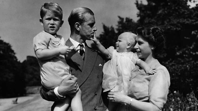 Then-Princess Elizabeth with her husband Prince Philip, the Duke of Edinburgh, and their children Prince Charles and Princess Anne at the couple's London residence at Clarence House in 1951 (AP Photo/Eddie Worth, file)