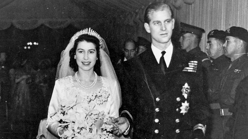 The then-Princess Elizabeth, and her husband, later the Duke of Edinburgh, on their wedding day. (Photo by Hulton Archive/Getty Images)