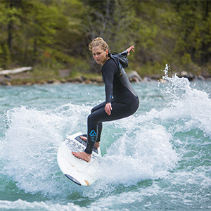 Angela Knox surfs on the Kananaskis river