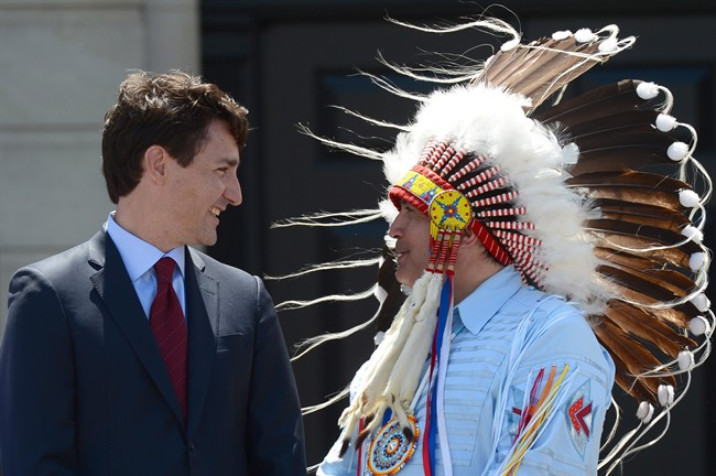 Prime Minister Justin Trudeau Perry Bellegarde, national chief of the Assembly of First Nations, celebrate National Indigenous Peoples Day in Ottawa on Wednesday, June 21, 2017. THE CANADIAN PRESS/Sean Kilpatrick