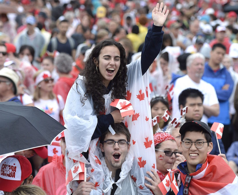 People cheer during the Canada Day noon hour show on Parliament Hill in Ottawa on Saturday, July 1, 2017. THE CANADIAN PRESS/Justin Tang