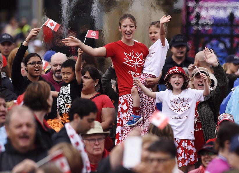 People take in the Canada 150 celebrations on Parliament Hill in Ottawa on Saturday, July 1, 2017. THE CANADIAN PRESS/ Justin Tang