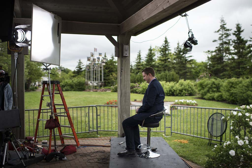 Conservative Party Leader Andrew Scheer prepares for an on-air interview with the CBC's Peter Mansbridge in Charlottetown, P.E.I. on Canada Day, Saturday, July 1, 2017. (Photograph by Darren Calabrese)