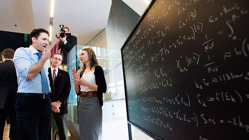 Prime Minister Justin Trudeau looks at a chalk board before making an announcement at the Perimeter Institute for Theoretical Physics in Waterloo, Ont., on Friday, April 15, 2016. (Nathan Denette/CP)