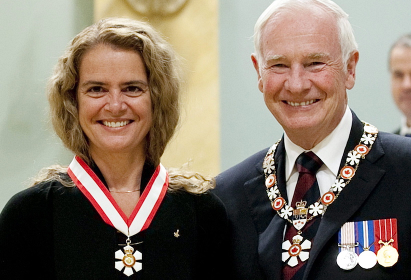 Canadian astronaut Julie Payette of Montreal stands with Governor General David Johnston after she was invested into the Order of Canada as Officer during a ceremony at Rideau Hall in Ottawa, Friday September 16 2011 . THE CANADIAN PRESS/Fred Chartrand