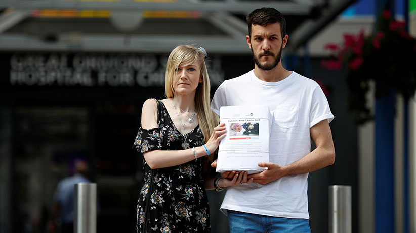 The parents of critically ill baby Charlie Gard, Connie Yates and Chris Gard, pose for the media with a petition, outside Great Ormond Street Hospital, in central London, Britain July 9, 2017. The parents want their son, who has a form of mitochondrial disease, to be able to travel to receive further treatment, after losing a long legal battle to give him experimental therapy in the United States. (Peter Nicholls/Reuters)