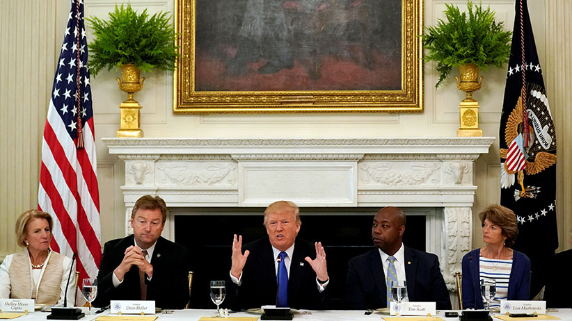U.S. President Donald Trump speaks during a lunch meeting with Senate Republicans to discuss healthcare at the White House in Washington, U.S., July 19, 2017. From left are U.S. Senators Shelley Moore Capito (R-WV), Dean Heller (R-NV), Tim Scott (R-SC) and Lisa Murkowski (R-AK). (Kevin Lamarque/Reuters)