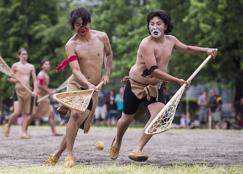 First Nations youth participate in a traditional Lacrosse game in Montreal, Saturday, June 17, 2017. THE CANADIAN PRESS/Graham Hughes