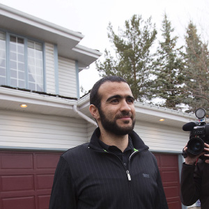 Omar Khadr walks to meet the press before a news conference after being released on bail in Edmonton, Alberta, May 7, 2015. Khadr, a Canadian, was once the youngest prisoner held on terror charges at Guantanamo Bay. (Todd Korol/Reuters)