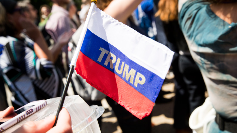 """Trump"" emblazoned on a Russian flag is held by a demonstrator outside the White House in Washington during protests against the firing of FBI Director James Comey, Wednesday, May 10, 2017. (Doug Mills/The New York Times/Redux)"