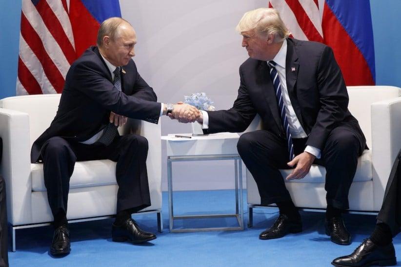 President Donald Trump shakes hands with Russian President Vladimir Putin at the G20 Summit at the G20 Summit, Friday, July 7, 2017, in Hamburg. (AP Photo/Evan Vucci)