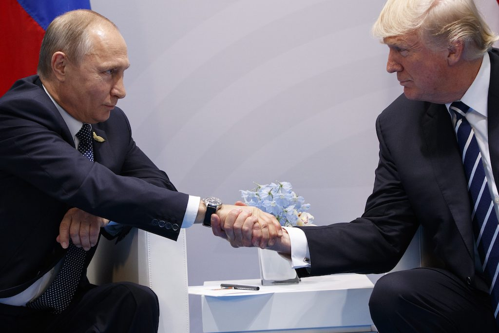 President Donald Trump shakes hands with Russian President Vladimir Putin at the G20 Summit Friday