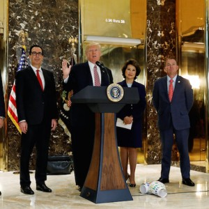 "U.S. President Donald Trump is flanked by (L-R) Director of the National Economic Council Gary Cohn, Treasury Secretary Steven Mnuchin, Secretary of Transportation Elaine Chao and Director of the Office of Management and Budget Mick Mulvaney as he speaks about the violence, injuries and deaths at the ""Unite the Right"" rally in Charlottesville while talking to the media in the lobby of Trump Tower in Manhattan, New York, U.S., August 15, 2017.   REUTERS/Kevin Lamarque"