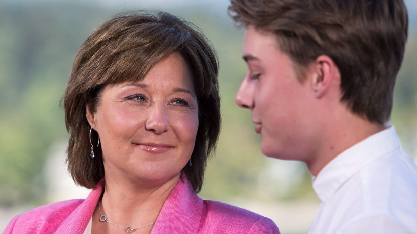Former B.C. premier Christy Clark speaks to media next to her son Hamish for the first time since announcing she will be stepping down as B.C. Liberal leader and MLA in Vancouver, B.C., on Monday, July 31, 2017. (Ben Nelms/CP)