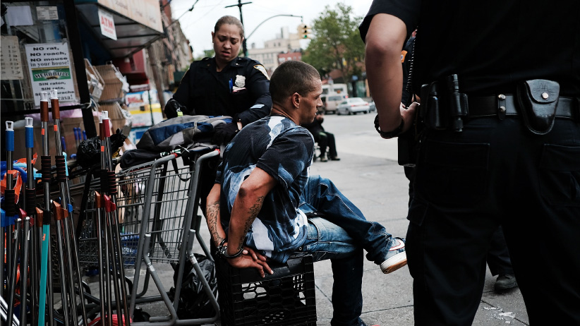 A man is arrested for drug use on a street in the South Bronx on June 7, 2017 in New York City. Like Staten Island, parts of the Bronx are experiencing an epidemic in drug use, especially heroin and other opioid based drugs. More than 1,370 New Yorkers died from overdoses in 2016, the majority of those deaths involved opioids. The Mott Haven-Hunts Point area of the Bronx borough of New York currently leads the city in heroin overdose deaths. According to the Deputy Attorney General, drug overdose are now the leading cause of death for Americans under the age of 50. (Spencer Platt/Getty Images)