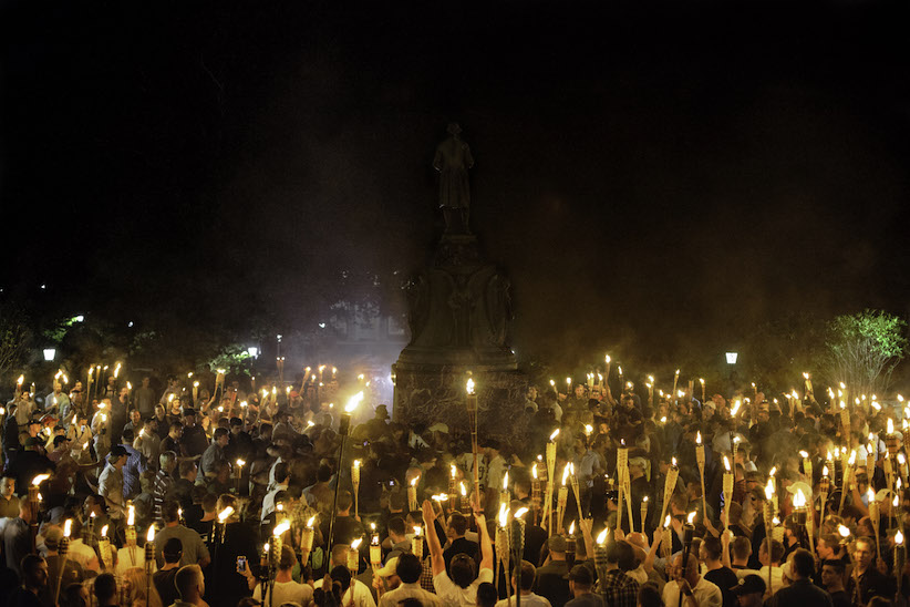 Marchers at a white-supremacy rally encircle counter protestors at the base of a statue of Thomas Jefferson after marching through the University of Virginia campus with torches in Charlottesville, Va., USA on August 11, 2017. (Shay Horse/NurPhoto via Getty Images)