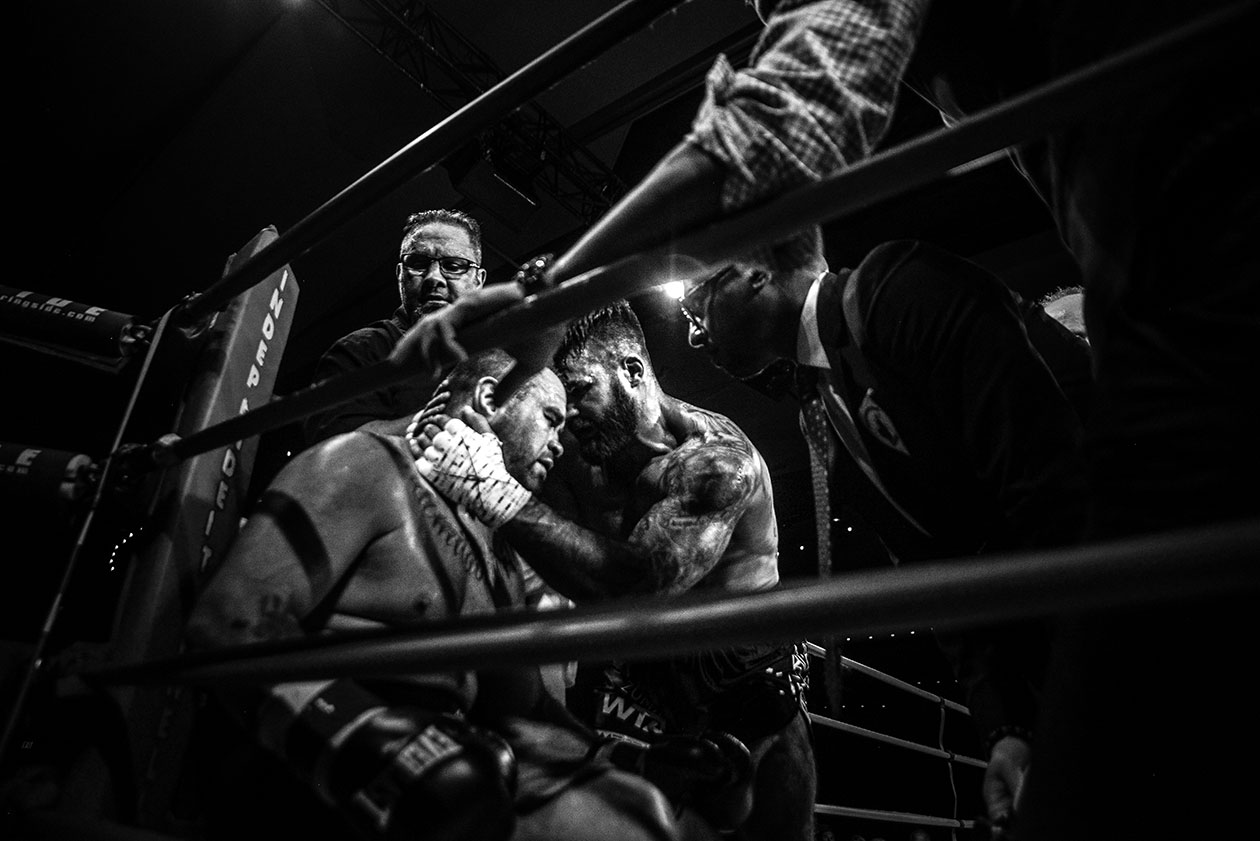 Adam Braidwood (right) comforts Tim Hague after helping him to his corner. (Jelena Kovacevic)