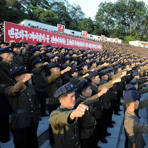 "This picture taken on August 11, 2017 and released by North Korea's official Korean Central News Agency (KCNA) on August 12, 2017 shows North Korean youths and workers and trade union members holding a rally to protest the UN Security Council's ""sanctions resolution"" at the Youth Park Open-Air theatre in Pyongyang. (STR/AFP/Getty Images)"