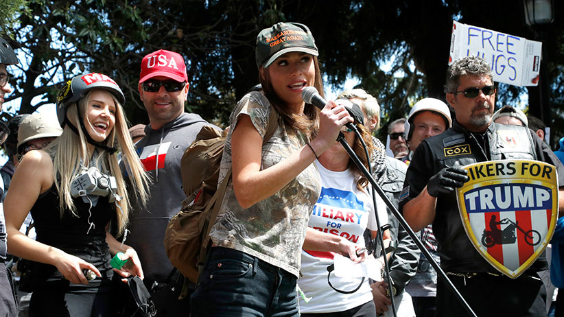 Faith Goldy (C), a Canadian right-wing social and political commentator speaks to supporters of US President Donald J. Trump as Lauren Southern (L), a Canadian conservative and libertarian activist listens at an event at the Martin Luther King Jr. Civic Center Park in Berkeley, California, USA, 27 April 2017. (John G. Mabanglo/EPA/CP)