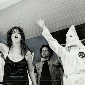 CANADA - JUNE 01: Noisy defiance: Members of the Ku Klux Klan; on the verandah of a Dundas St. E. house in May; raise arms in Nazi-style salute and shout at marchers from Riverdale Action Committee Against Racism who were protesting the Klan's activities. The committee had been infiltrated by the chief of the klan's intelligence agency (KIA). Insight (Photo by David Cooper/Toronto Star via Getty Images)