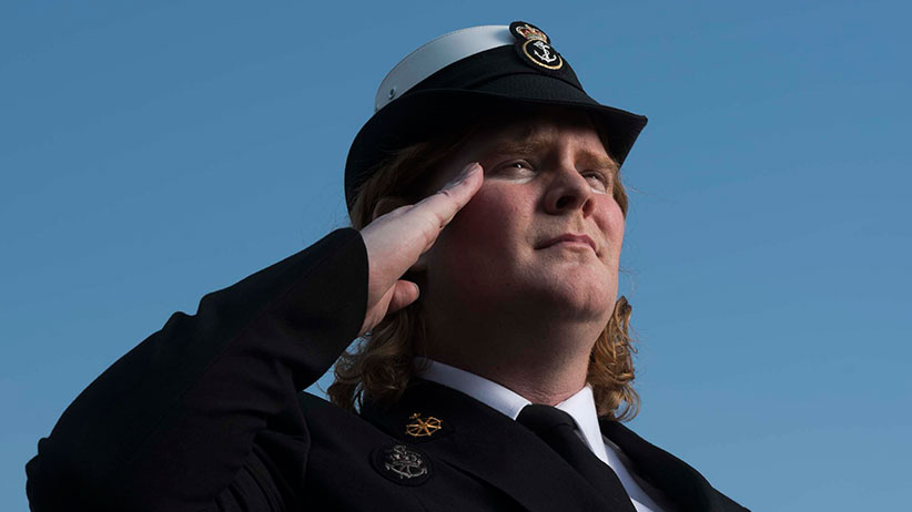 Leading Seaman Danielle Dewitt poses near HMCS Toronto on a jetty in the Canadian Forces naval dockyard in Halifax. (Photograph by Darren Calabrese)