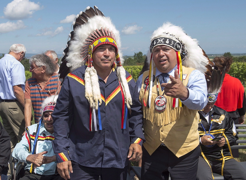 Perry Bellegarde, left, national chief of the Assembly of First Nations, chats with Morley Googoo, regional chief for Nova Scotia and Newfoundland, at a meeting of Atlantic MPs and First Nations chiefs in Wolfville, N.S. on Thursday, Aug. 10, 2017. THE CANADIAN PRESS/Andrew Vaughan