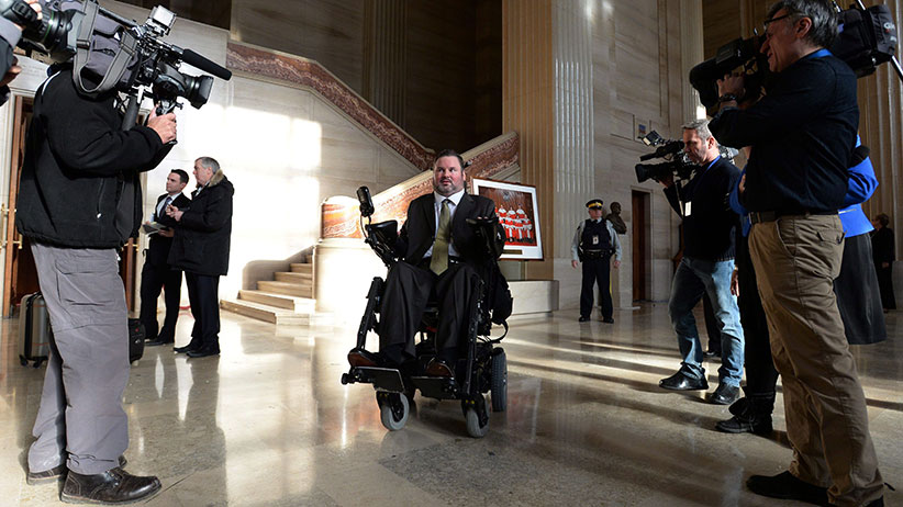 "Conservative MP Steven Fletcher makes his way through the foyer of The Supreme Court of Canada in Ottawa on Friday morning, Feb. 6, 2015. The Supreme Court unanimously struck down the ban on providing a doctor-assisted death to mentally competent but suffering and ""irremediable"" patients. (Sean Kilpatrick/CP)"