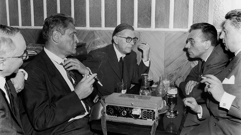 Writers Joseph KESSEL Jean-Paul SARTRE and, to the latter's right, the reporter Roger PRIOURET conversing at the close of reporter Georges ARNAUD's trial. ARNAUD was sentenced to a two year suspended prison sentence. The scene takes place in a Paris cafe near the military tribunal of Paris, on June 18, 1960.  (Keystone-France/Gamma-Keystone/Getty Images)
