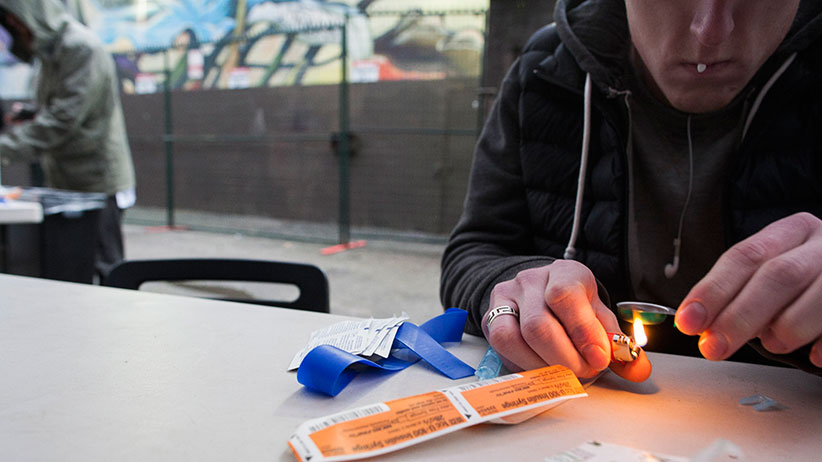 A drug user at a popup safe injection tent in Vancouver.