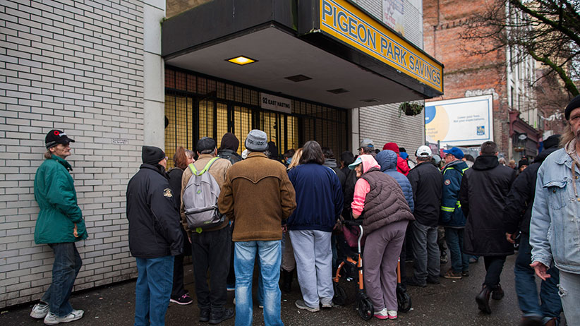 Crowd outside Pigeon Park Savings in Vancouver
