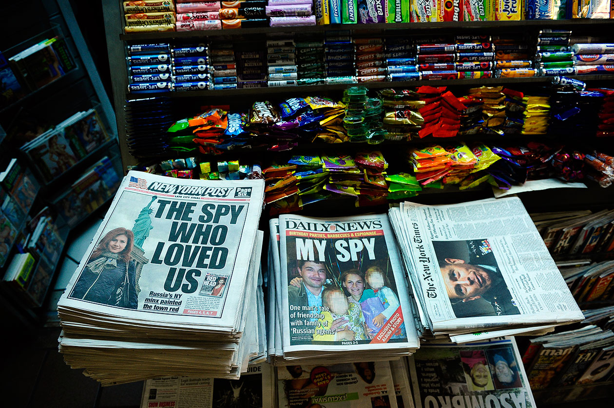 Newspaper front pages about Russian spies captured inside the U.S.