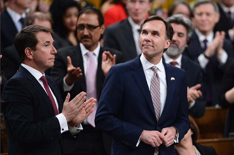 Liberal Members of Parliament give Minister of Finance Bill Morneau a standing ovation as he delivers the federal budget in the House of Commons on Parliament Hill in Ottawa, Wednesday March 22, 2017. (Sean Kilpatrick/CP)