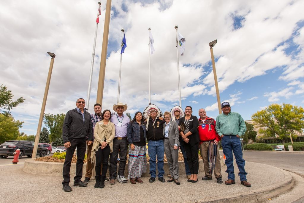 Representatives of Lethbridge College and Alberta Blackfoot Nations celebrate the new flag near the main entrance of campus (Submitted)