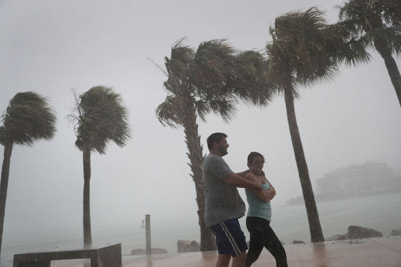 People walk through high winds and rain as Hurricane Irma approaches on September 9, 2017 in Miami Beach, Florida. Florida is in the path of the Hurricane which may come ashore at category 4. (Joe Raedle/Getty Images)