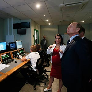 "Russian President Vladimir Putin, right, visits the new headquarters of the ""Russia Today"" television channel in Moscow, Russia in June 2013"
