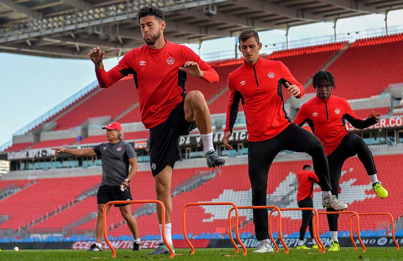 Players on Canada's men's national soccer train before a friendly against Jamaica at BMO Field in Toronto in September 2017