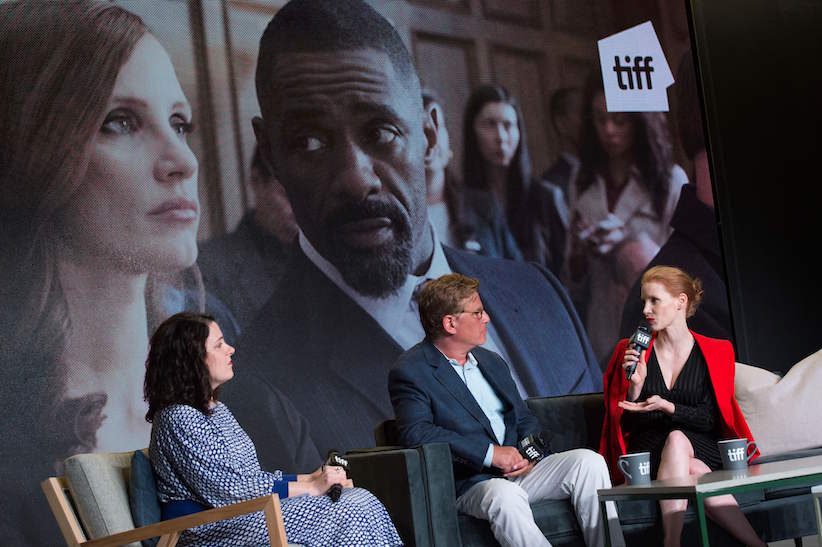 "Writer/Director Aaron Sorkin (C) and actress Jessica Chastain attend the press conference for ""Molly's Game"" during the 2017 Toronto International Film Festival at TIFF Bell Lightbox September 9, 2017, in Toronto, Ontario. (Photo credit: VALERIE MACON/AFP/Getty Images)"