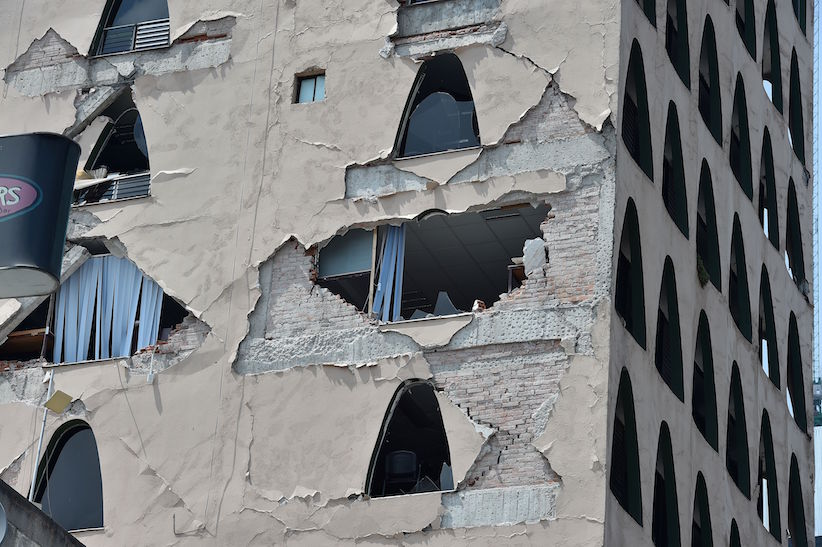 Picture of the damages caused on a building by a powerful quake in Mexico City on September 19, 2017. A powerful earthquake shook Mexico City on Tuesday, causing panic among the megalopolis' 20 million inhabitants on the 32nd anniversary of a devastating 1985 quake. The US Geological Survey put the quake's magnitude at 7.1 while Mexico's Seismological Institute said it measured 6.8 on its scale. The institute said the quake's epicenter was seven kilometers west of Chiautla de Tapia, in the neighboring state of Puebla. / AFP PHOTO / Yuri CORTEZ (Photo credit should read YURI CORTEZ/AFP/Getty Images)