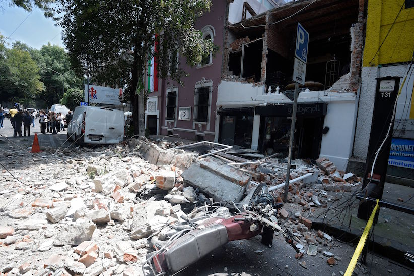 Picture of debris of the facade of a building which collapsed when a quake rattled Mexico City on September 19, 2017. A powerful earthquake shook Mexico City on Tuesday, causing panic among the megalopolis' 20 million inhabitants on the 32nd anniversary of a devastating 1985 quake. The US Geological Survey put the quake's magnitude at 7.1 while Mexico's Seismological Institute said it measured 6.8 on its scale. The institute said the quake's epicenter was seven kilometers west of Chiautla de Tapia, in the neighboring state of Puebla. / AFP PHOTO / Alfredo ESTRELLA (Photo credit should read ALFREDO ESTRELLA/AFP/Getty Images)