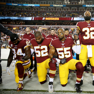 LANDOVER, MD - SEPTEMBER 24: Washington Redskins players during the the national anthem before the game against the Oakland Raiders at FedExField on September 24, 2017 in Landover, Maryland. (Photo by Patrick Smith/Getty Images)