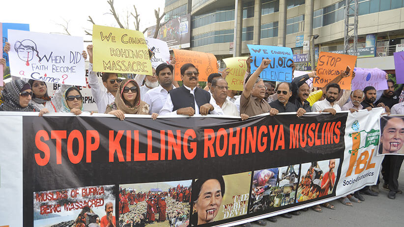 "In Lahore, Pakistan, protesters carry a banner reading ""stop killing rohingya muslims"""