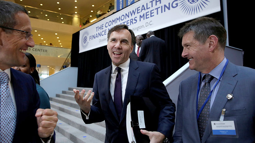 Canadian finance minister Bill Morneau (C) reacts after The Commonwealth Finance Ministers meeting family photo during the IMF/World Bank annual meetings in Washington, U.S., October 12, 2017. (Yuri Gripas/Reuters)