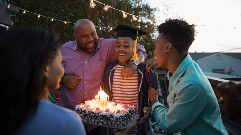 Family celebrating a graduation. (Hero Images/Getty Images)
