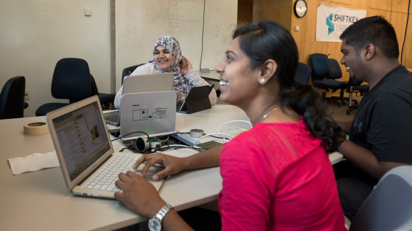 RovBOT immigration and visas: RovBOT co-founders, from left to right, Ruhi Madiwale, Dhivya Jayaraman, and JeyaBalaji Samuthiravelu work in the Shiftkey labs at Dalhousie University where they share the space with other companies. (Photograph, Darren Calabrese)