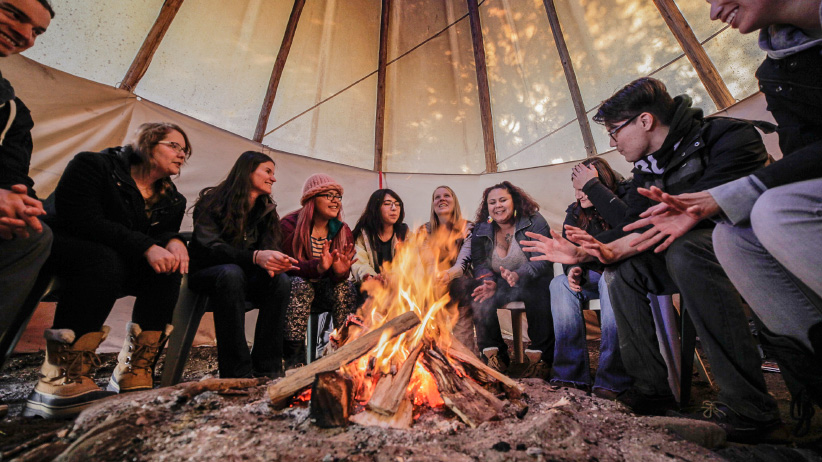 First Nations university education - Class taking place in a tipi at Trent University. (Photo, Trent University)
