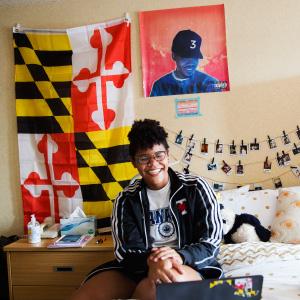 American teenager Rebekah Robinson who has studied in Russia and France, speaks both languages and is currently studying at the University of Toronto, poses for a photo in her dorm room backdropped by her home state flag of Maryland in Toronto on September 20, 2017. (Photograph by Michelle Siu)
