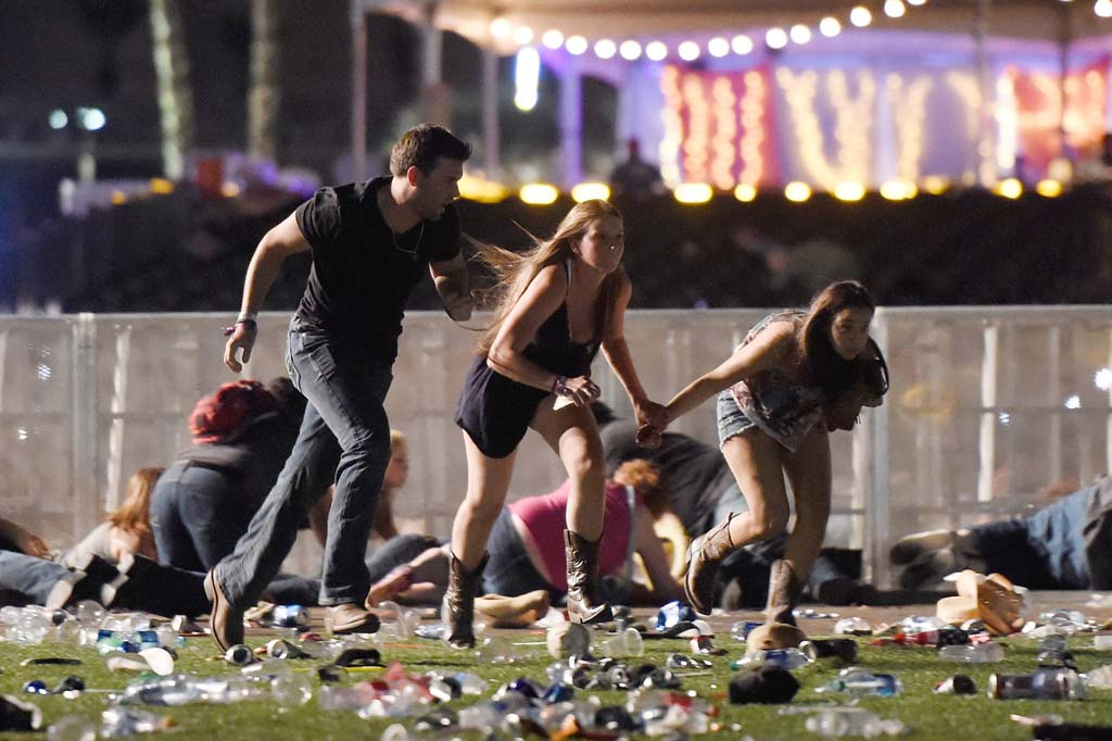 <p>People run from the Route 91 Harvest country music festival after an assailant opened fire from a nearby hotelin the early morning of October 2, 2017 in Las Vegas, Nevada. (David Becker/Getty Images)</p>